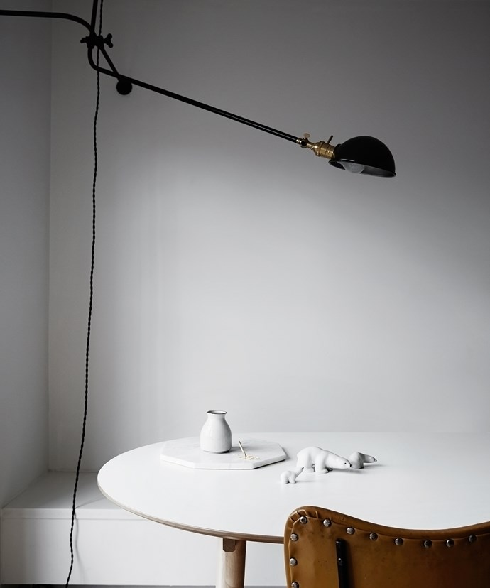 """Preferring clean lines and minimalist pieces, Rhiannon and Matt have gone for a mid-century modern interior, seen in small details such as these cute polar bear figures, simple marble trivet and small vessel – all in cool white.   Corner **lamp** from [Workstead](http://www.workstead.com/