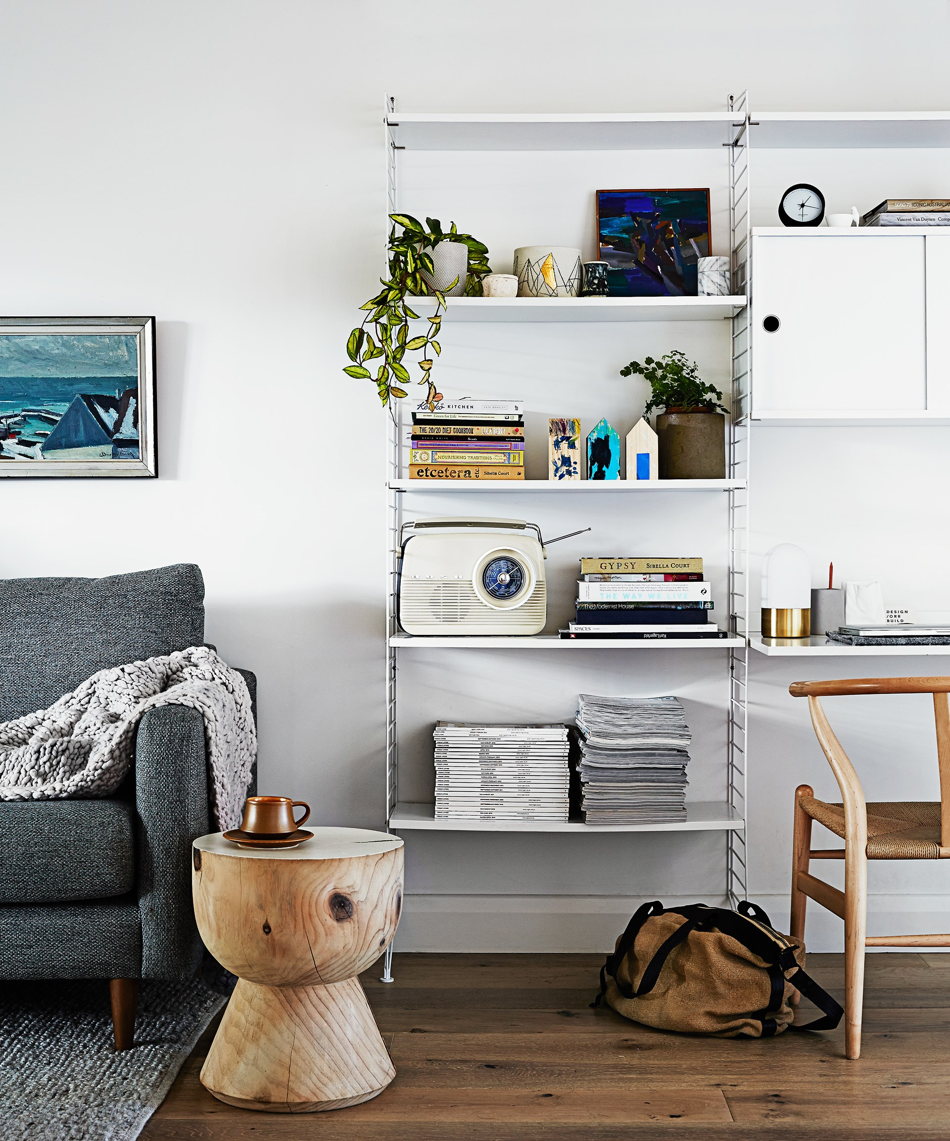 "The designer [String](https://string.se/|target=""_blank"") shelving system in this [mid-century modern home](http://www.homestolove.com.au/gallery-matt-and-rhiannons-mid-century-modern-home-1966