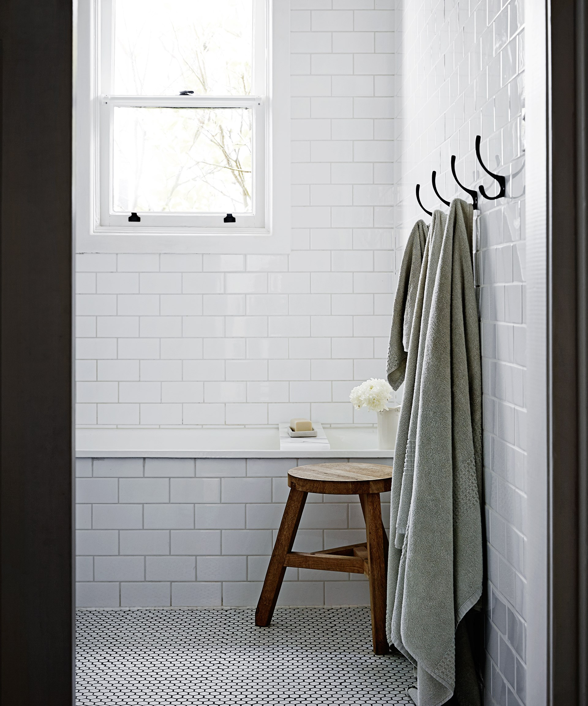 The original cast-iron bath was kept and refinished to retain the heritage charm of this [mid-century modern Melbourne home](http://www.homestolove.com.au/gallery-matt-and-rhiannons-mid-century-modern-home-1966). Photo: Sharyn Cairns