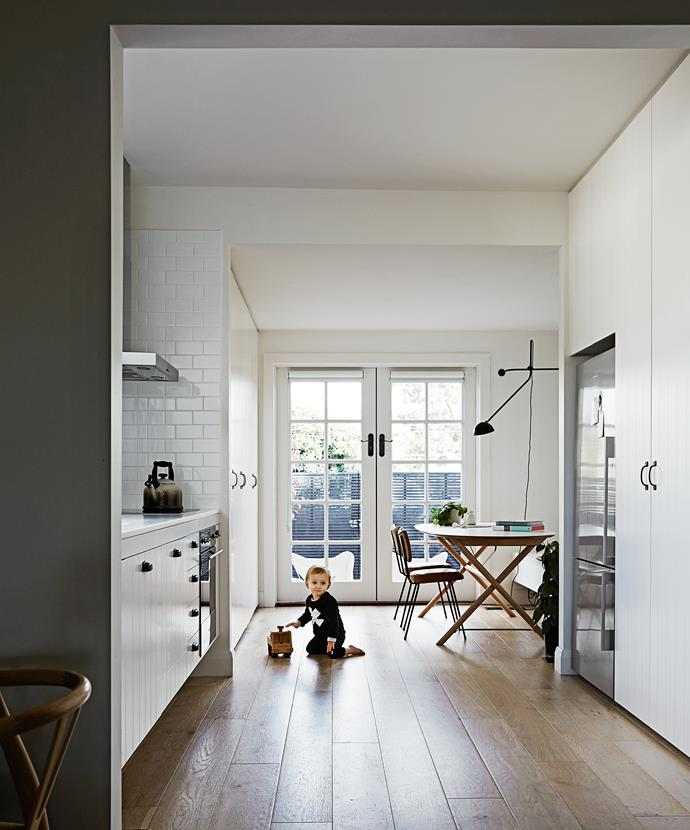 """""""I love my kitchen!"""" Rhiannon says. """"While it's petite in size, its layout is super-functional."""" Clutter is housed by floor-to-ceiling joinery by [Avram Construction](http://www.avramconstruction.com.au/