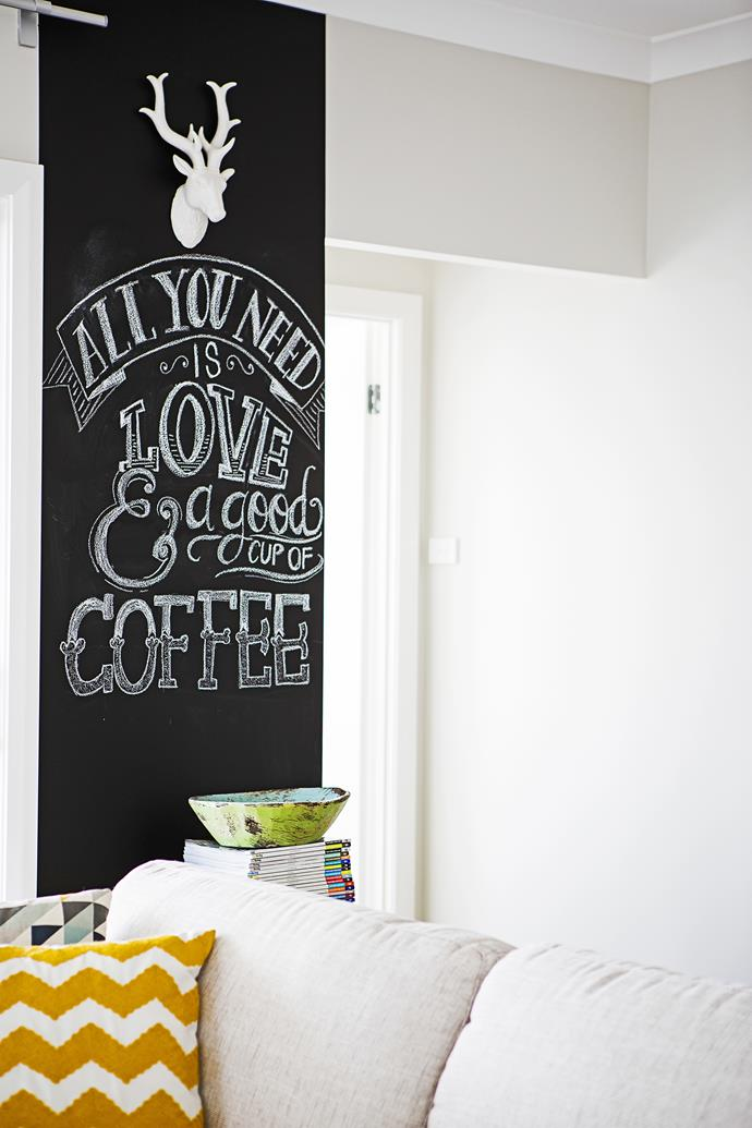 """""""We had a chalkboard wall in our last house and loved it, so we decided to do it again in this house. I love changing the artwork up most weeks,"""" Katie says. Photo: Maree Homer"""