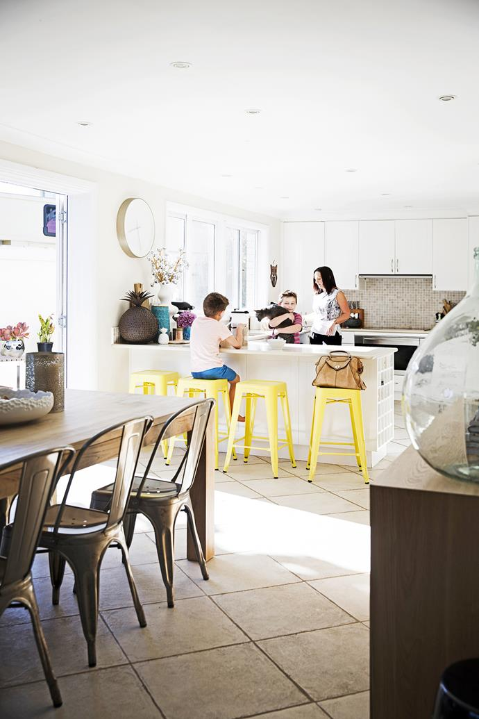Yellow stools from Stainless Steel Australia add a splash of colour and fun in the kitchen.