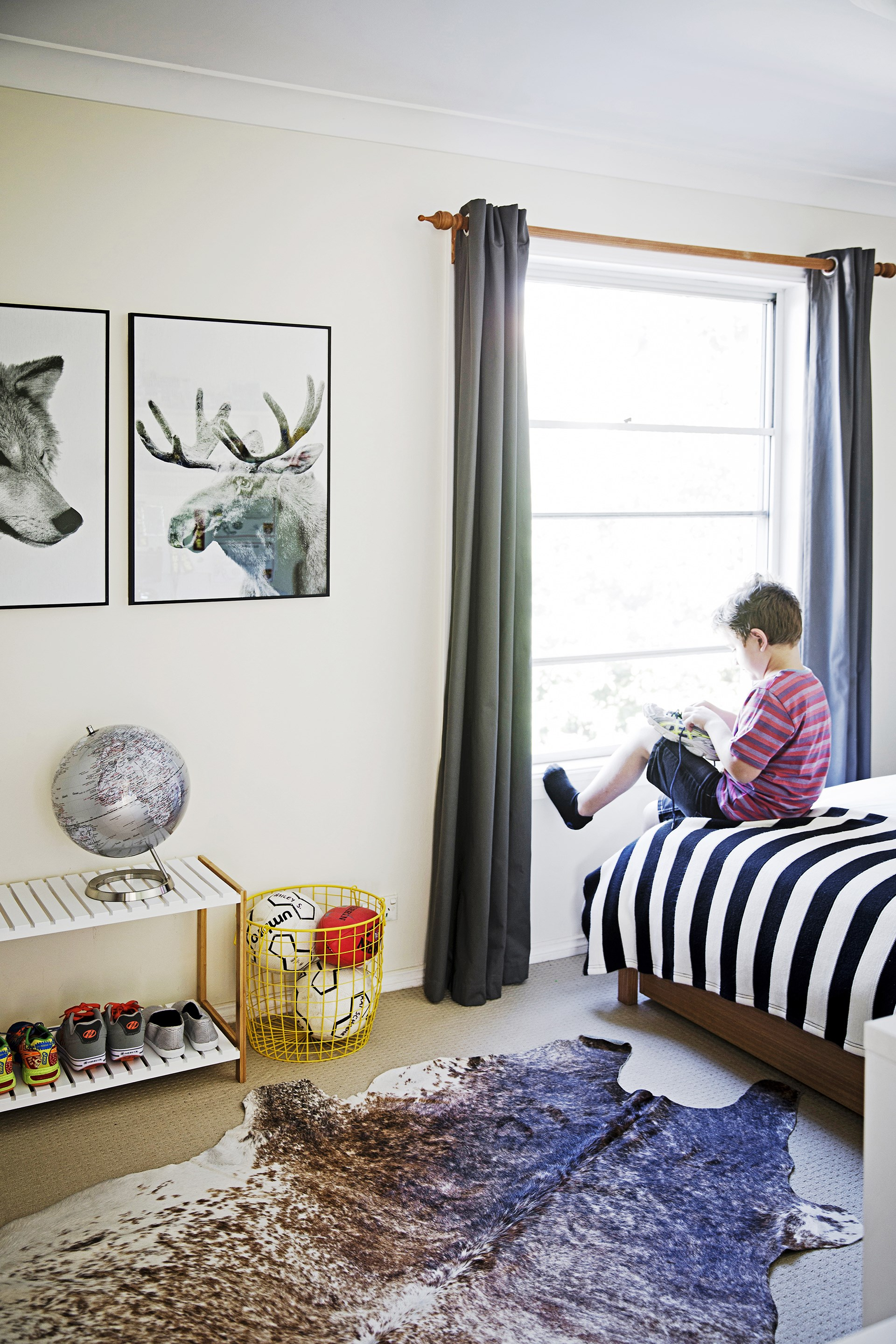 "A wire bin keeps Nick's collection of balls from bouncing away in this [character-filled coastal home](http://www.homestolove.com.au/inspiring-kids-bedrooms-2226|target=""_blank""). Photo: James Henry / *homes+*"