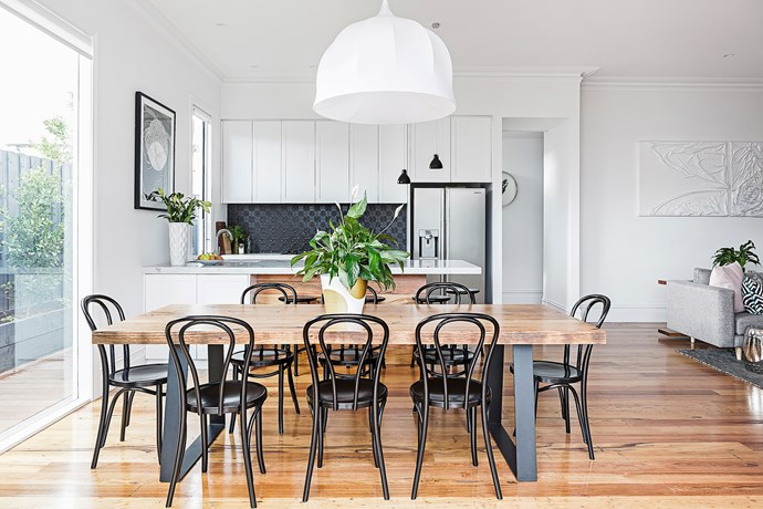 Rachel loves the way the timber flooring continues up the back of the kitchen bench. It matches the dining table perfectly.  Bentwood **chairs** in Black from [Connect Furniture].