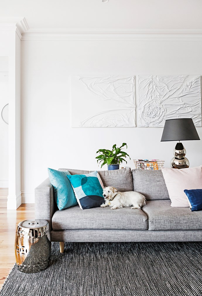 """The white textured artwork was made by a friend. Cushion in Mint from [Curious Grace](http://www.curiousgrace.com.au/ target=""""_blank""""). On the couch is Jack, the family's wire-coat Jack Russell."""