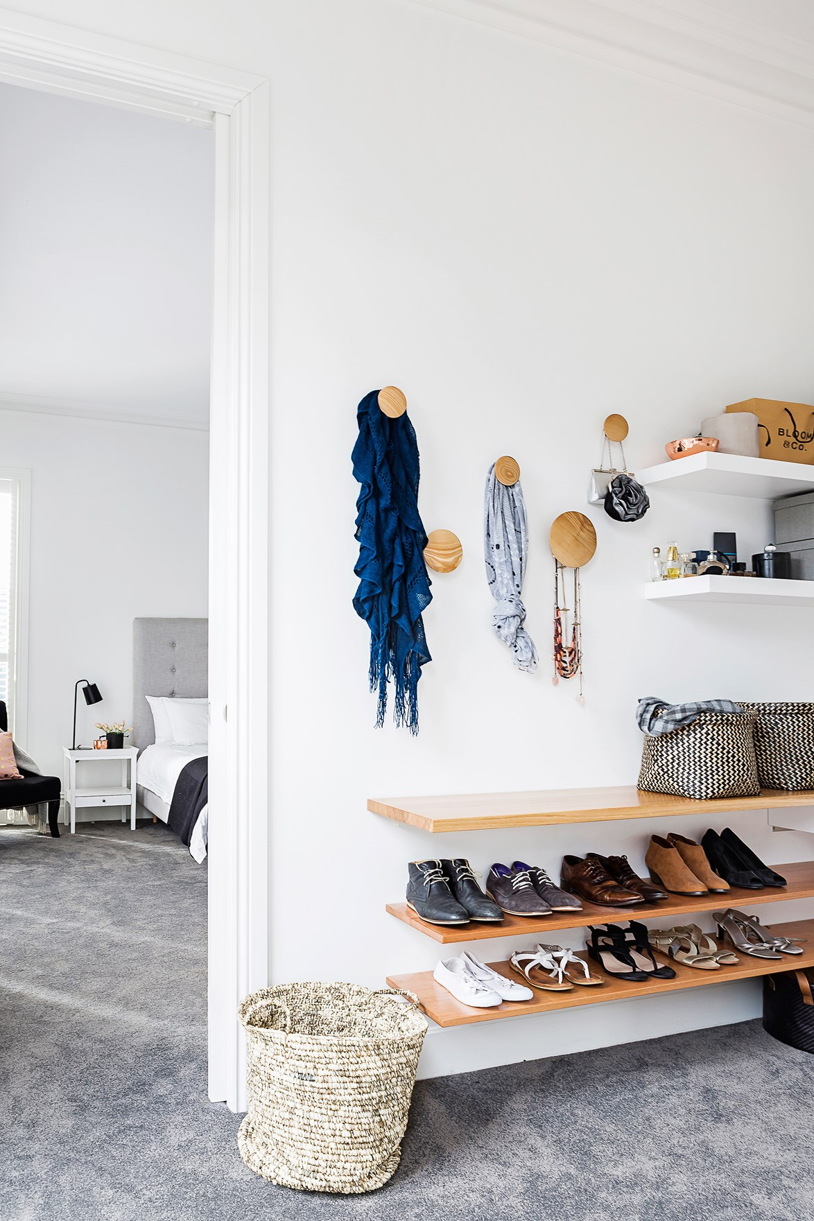 Wall hooks, mounted shelves and baskets are all fantastic space-saving storage solutions. Photo: Maree Homer / homes+
