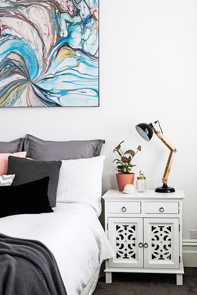 """In Gabrielle's room, the blush, white and charcoal bedlinen perfectly suits an artwork from Bali.   Meyer 1 Light **table lamp** from [Beacon Lighting](http://www.beaconlighting.com.au/ target=""""_blank"""")."""