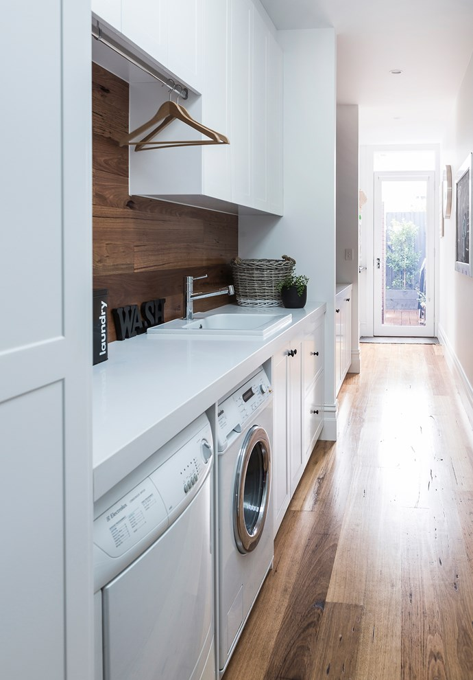A narrow hallway leading to the backyard was turned into a practical yet pretty internal laundry.