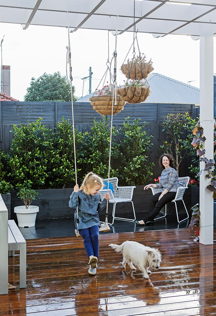 """""""I wanted a classic country feel with a deck running around the house,"""" Rachel says. Daughter Lily plays on her swing from [Bunnings](http://www.bunnings.com.au/ target=""""_blank"""")."""