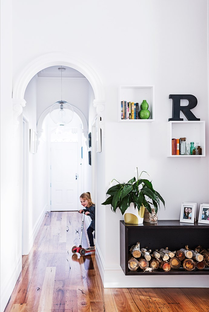 To add more character and a seamless look, the couple had an extra hallway arch installed.