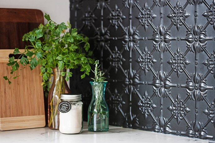 """""""I love bits of black to pop,"""" Rachel says, """"like the kitchen splashback, which is pressed metal painted in matt black."""""""
