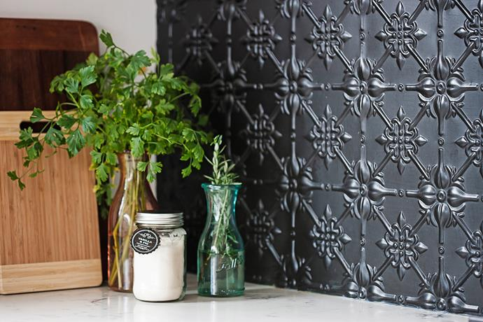 """I love bits of black to pop,"" Rachel says, ""like the kitchen splashback, which is pressed metal painted in matt black."""