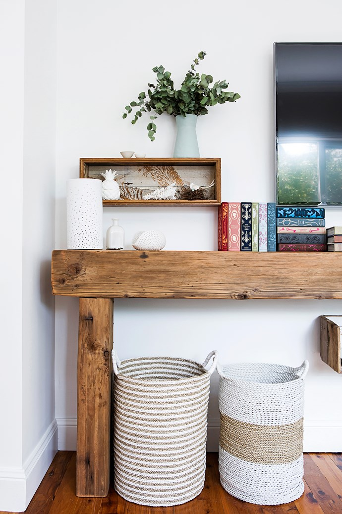 The timber console was made by Connor and is accompanied by classic white ornaments.