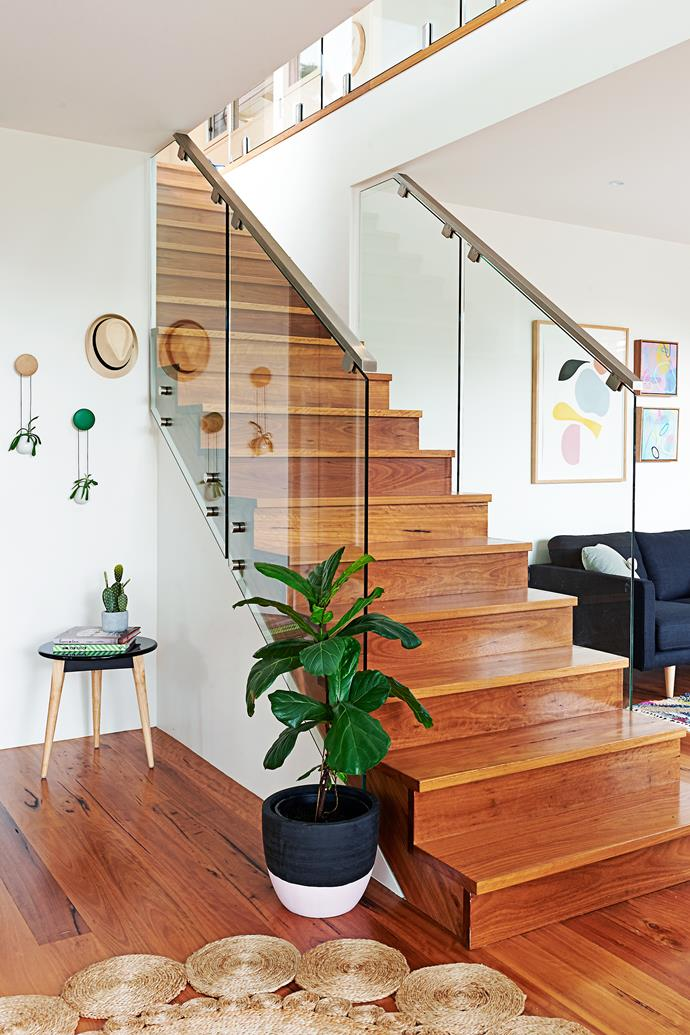 """A cute side table brings interest to the corner, while a Fiddle leaf fig is at home by the stairs.  Tripod **side table** from [Adairs](https://www.adairs.com.au/
