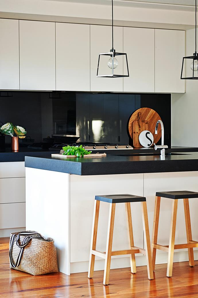 """The kitchen is Sarah's favourite room, with its island bench, concealed fridge and storage space – and she plans to copy its design in a future build. The bar stools are from [Schiavello](http://www.schiavello.com/