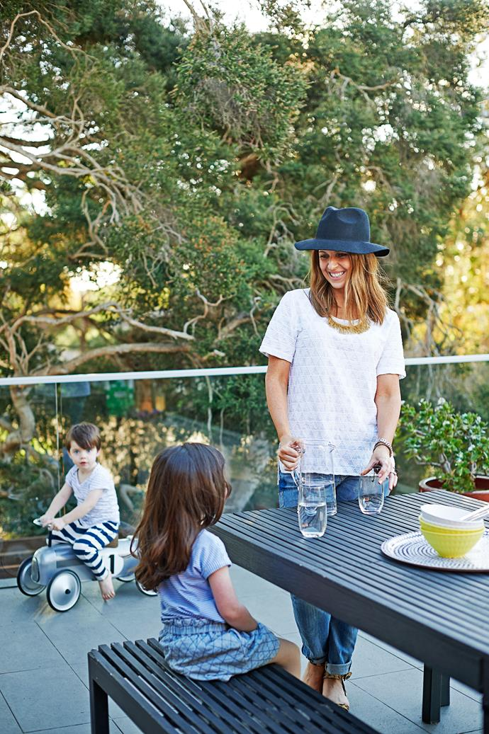 """Sarah, Liv and Ryder cool off with a cold drink on the spacious and much-used terrace, another """"room"""" in the house."""
