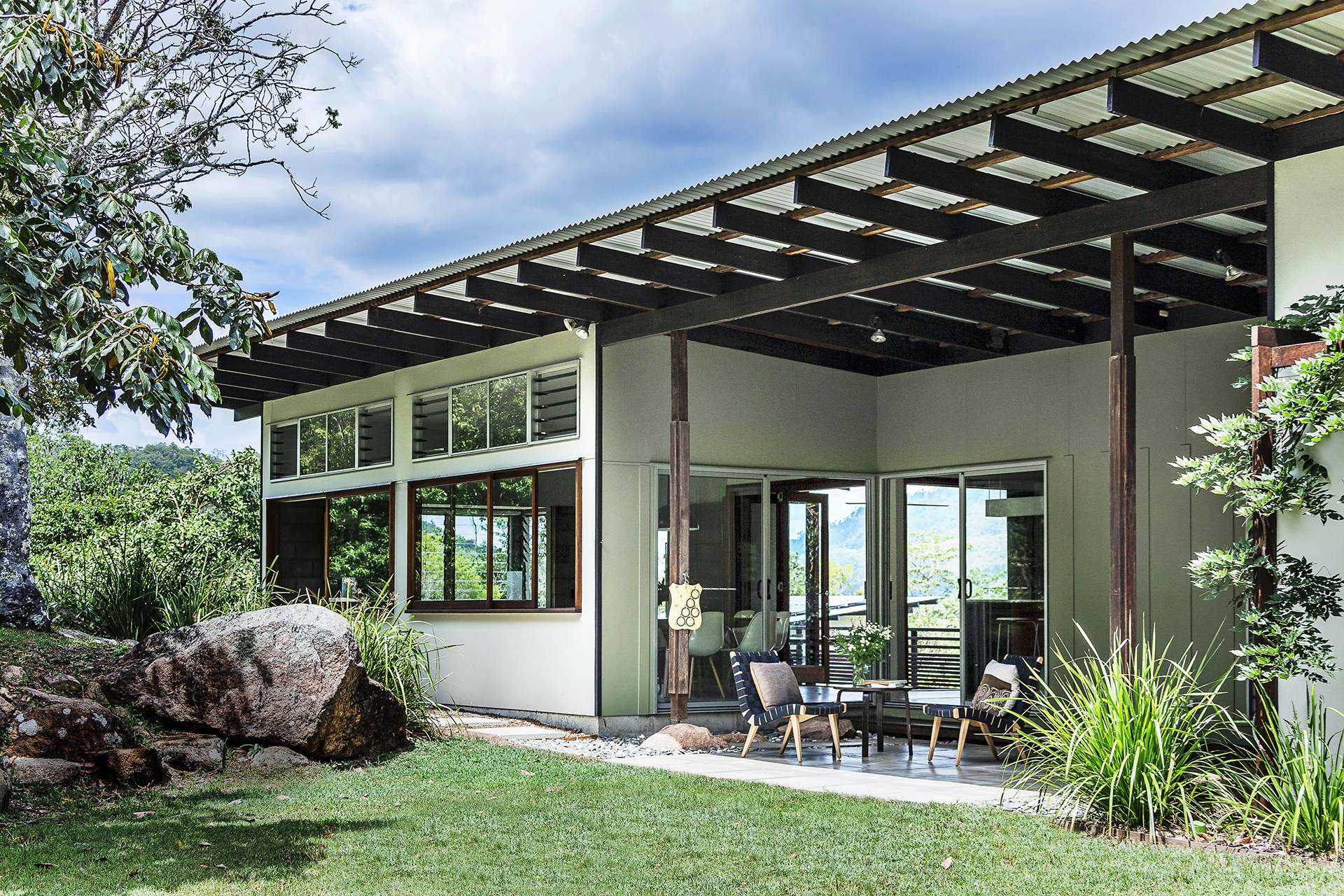 This eco-friendly home was built in four stages over eight years on a tranquil 2-hectare block in the hinterland behind Brisbane. Find out more about this [beautiful bush home](http://www.homestolove.com.au/gallery-chris-and-sonias-eco-friendly-queensland-bush-home-1990). Photo: Maree Homer / *Australian House & Garden*