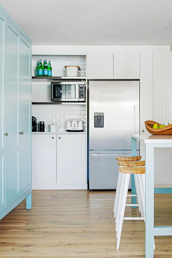 Andrew designed an appliance cupboard with bifold doors that allows this busy area to be easily closed off when the family is entertaining, an important consideration when the kitchen is open to social areas. Photo: Nicholas Watt