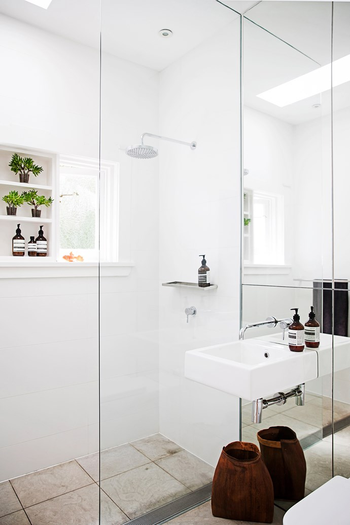 The old bathroom has been renovated. The addition of a floor-to-ceiling mirror and a frameless shower screen maximise the sense of light and space in the small room.