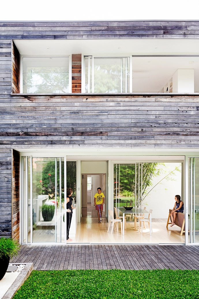To achieve the Swiss-style look, homeowners Ariana and Peter Koller used traditional recycled hardwood shiplapped cladding on the exterior of their family home in Sydney's Earlwood, where a two-storey extension has been added at the back of the old single-storey cottage. Upstairs is a bedroom, ensuite, living area and balcony. Downstairs are the new kitchen, dining and living areas.