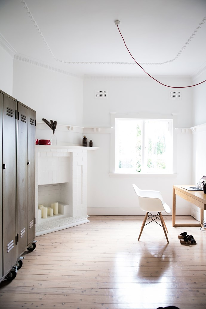 Vintage school lockers used as storage bring an industrial edge to this light and bright study.