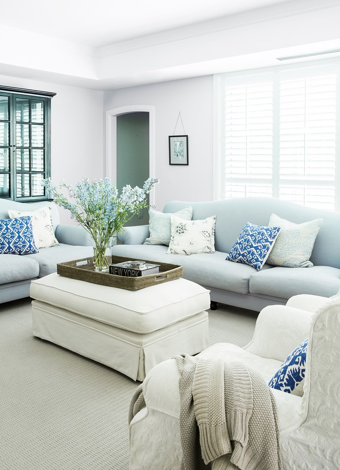 """Canberra might be far from the sea but the signature cool coastal palette of Hamptons style works beautifully – especially here in the living room.   **Sofas** and **ottoman** from [Domayne](http://www.domayneonline.com.au/