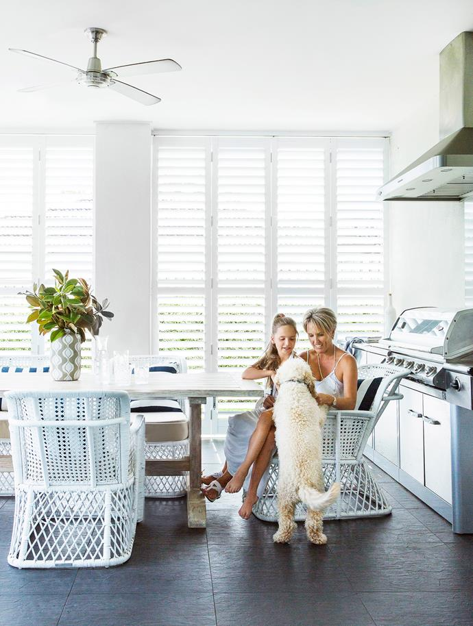 """Homeowner Claire and her daughter Tara take advantage of cool cross-breezes in the outdoor room.   Plantation **shutters** from [BASC](http://www.bascact.com.au/