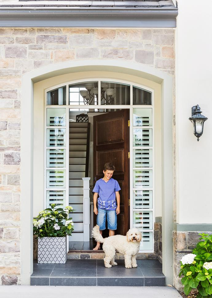 """Louie the Spoodle is happy to help welcome visitors to this [Hampton-esque home in Canberra](http://www.homestolove.com.au/gallery-claires-hamptons-inspired-canberra-home-2011/