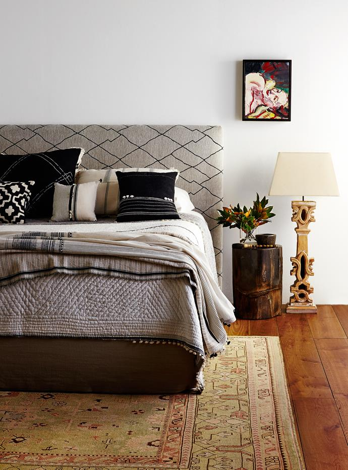 """A Jacquard print is the perfect backdrop to a monochrome arrangement of pillows and oriental accents.   Portobello **bedhead** from [Heatherly Design](http://www.heatherlydesign.com.au/ target=""""_blank"""") upholstered in Berba chenille jacquard fabric from [Mokum](http://www.jamesdunloptextiles.com/ target=""""_blank""""). Fossil wood **stool** from [Orient House](http://www.orienthouse.com.au/ target=""""_blank""""). Vintage terracotta **floor lamp** from [The Country Trader](http://www.thecountrytrader.com.au/ target=""""_blank""""). *Head of a Woman* **artwork** by Robert Malherbe from [Olsen Irwin](http://www.olsenirwin.com/ target=""""_blank""""). Oushak 2 wool **rug** from [Robyn Cosgrove](http://www.robyncosgrove.com/ target=""""_blank"""")."""