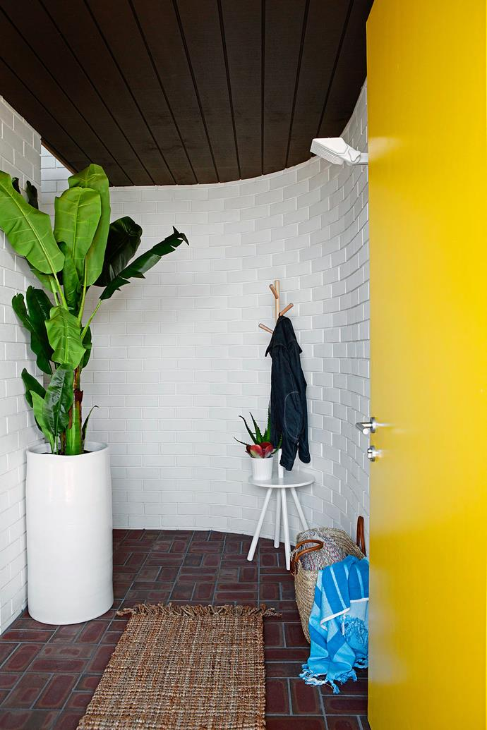 The yellow front door of this Perth house opens to reveal rich and textured yet practical surfaces. Coat rack from Freedom. Photo: Angelita Bonetti / bauersyndication.com.au