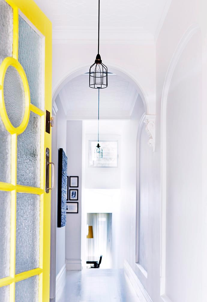 """Say hello with yellow: The owners of this renovated cottage painted the original front door in [Dulux](http://www.dulux.com.au/