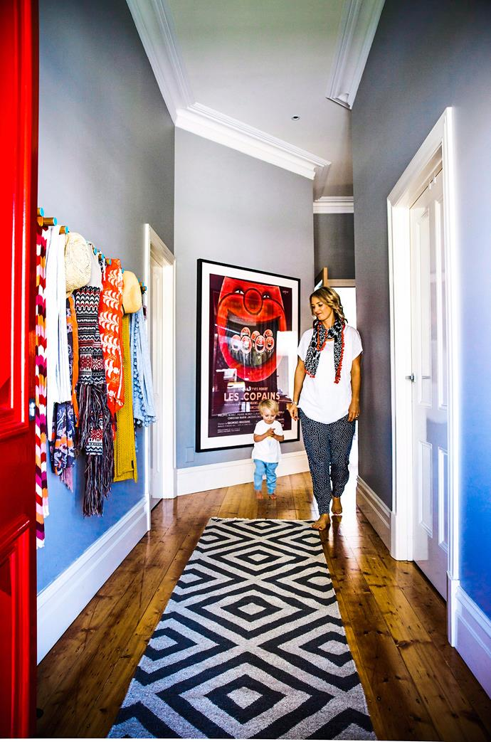 Scarves in an eclectic mix of colour and pattern, a geometric black and white rug, and a fire engine red front door bring a sense of fun to this Melbourne home. Photo: Scott Hawkins / bauersyndication.com.au