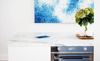 Modern built-in oven under marble kitchen bench
