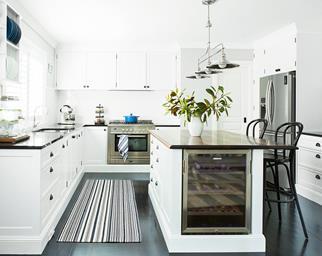 Hamptons-style white kitchen with wine fridge