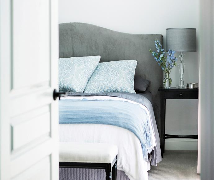 Hamptons-style master bedroom with a blue and grey colour scheme