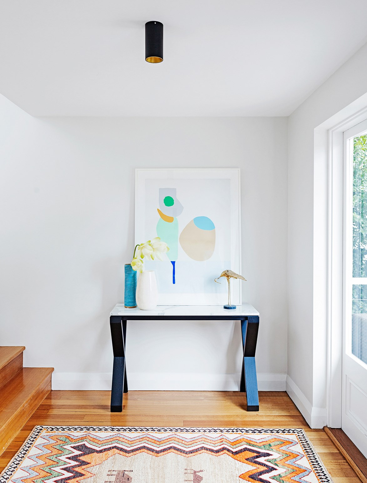 "A carefully considered display creates a warm welcome in the entryway of this [feminine Sydney home](https://www.homestolove.com.au/gallery-master-stroke-feminine-sydney-house-design-1-2021|target=""_blank""). *Photo:* Felix Forest"