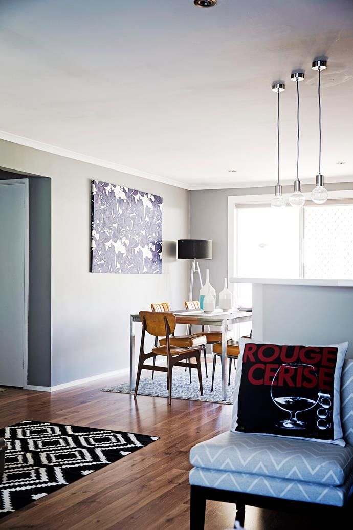 "A trio of pendant lights from [Beacon Lighting](http://www.beaconlighting.com.au/?utm_campaign=supplier/|target=""_blank"") visually separate the living and dining areas of Jet and Joey's home."