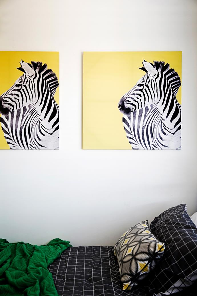 "Two zebra canvases from [Kmart](http://www.kmart.com.au/|target=""_blank"") were hung next to each other for a quirky feature."