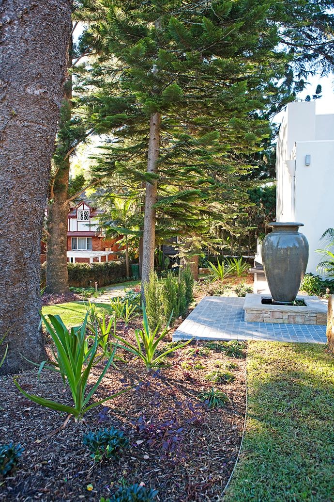 The water feature urn provides a focal point.