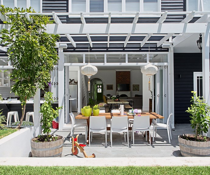 """Lanterns, candles and clusters of pot plants are some of the details used by Perth homeowner Suzanne Bellerby to add magic to her outdoor dining space. """"Decorating doesn't stop at the back door,"""" says Suzanne, who designed a servery at the kitchen window to make outdoor meals a breeze."""