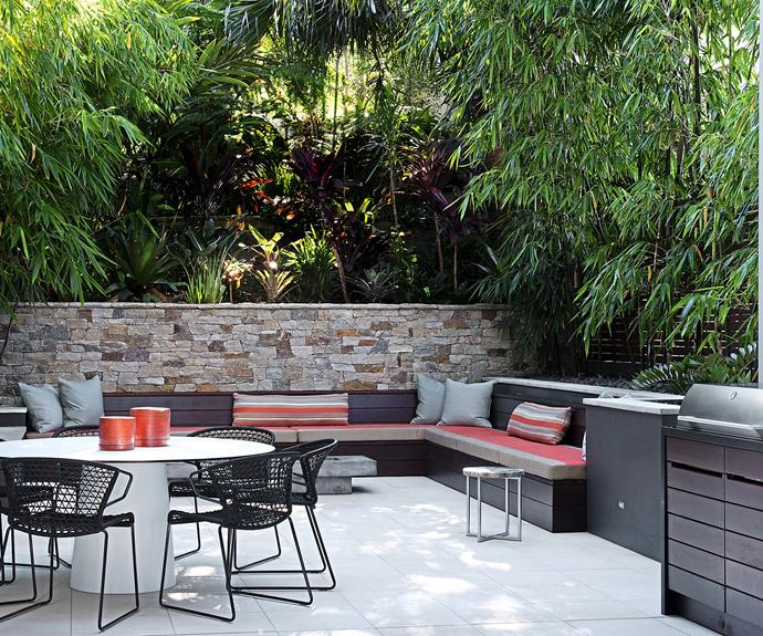 "This north-facing courtyard was created by interior designer [Justine Hugh- Jones](http://www.justinehughjones.com/?utm_campaign=supplier/|target=""_blank""). The key ingredients to this inviting space? ""Generous seating, lots of greenery, energising fabric colours and a round table for great conversation,"" says Hugh-Jones.  Popham Design Diamond in the Rough **wall tiles** from [Onsite Supply+Design](http://www.onsitesupply.com/?utm_campaign=supplier/