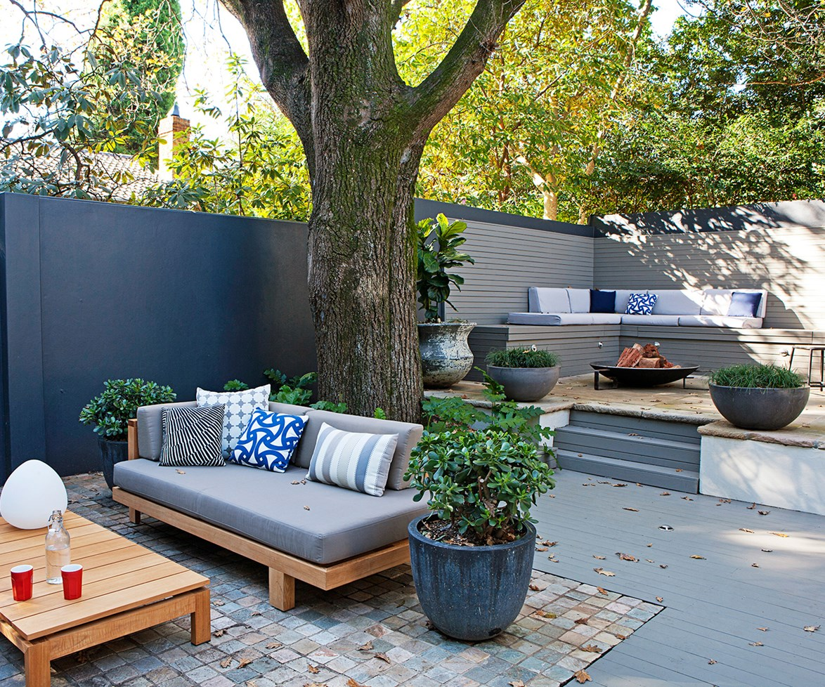 """Separating your backyard into zones creates different areas for guests to gather - ideal if you've invited a crowd. Read more about the [clever redesign of a rambling backyard](http://www.homestolove.com.au/michelles-multipurpose-garden-oasis-2047/?utm_campaign=supplier/