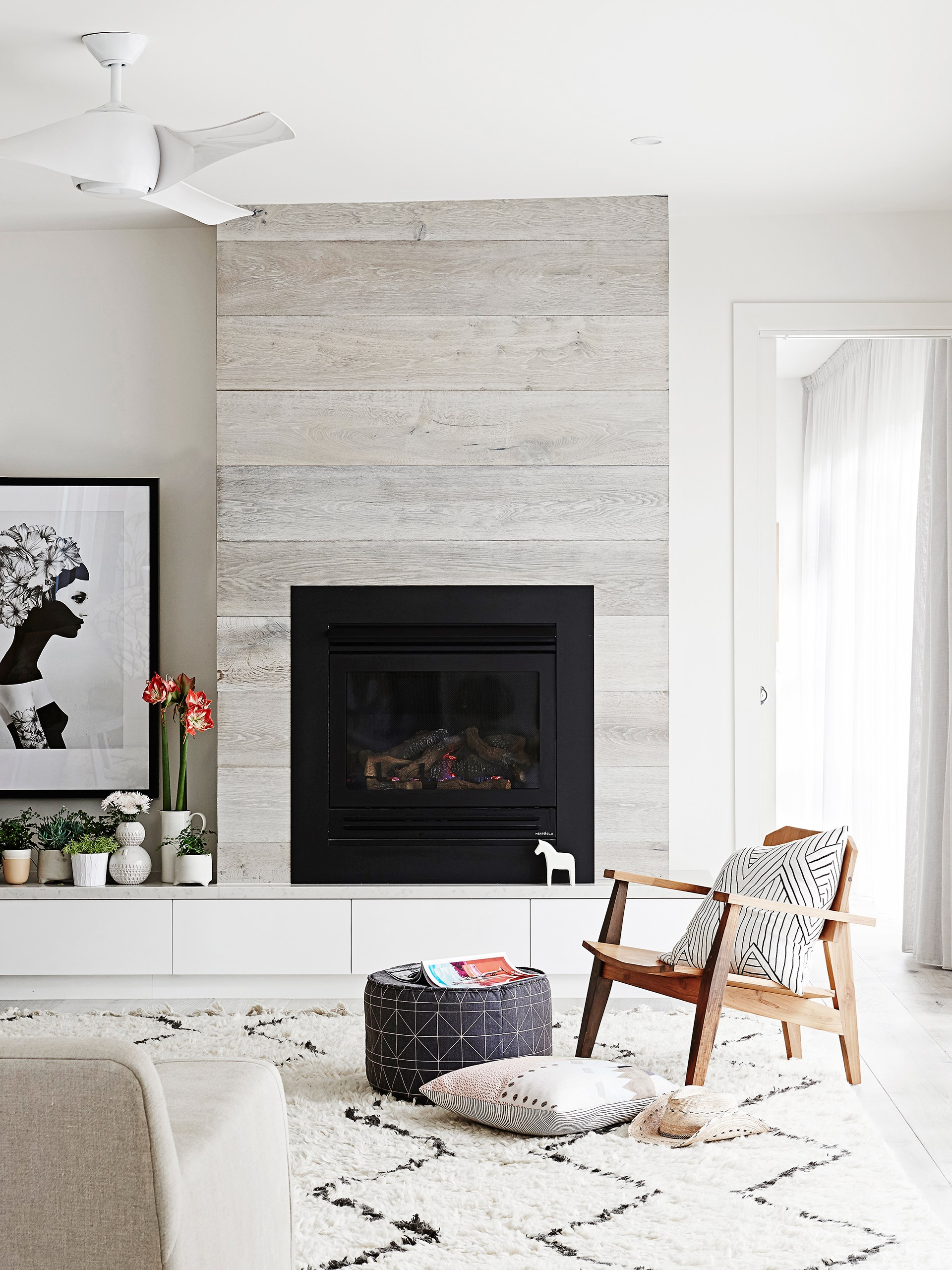 "[This renovated heritage bungalow](http://www.homestolove.com.au/karling-and-stevens-scandi-style-home-2055|target=""_blank"") was swept with a simple, sophisticated brush. The living room comes complete with a Heat & Glo fireplace. Marianna print by Ruben Ireland from [Norsu Interiors](http://www.norsu.com.au//?utm_campaign=supplier/