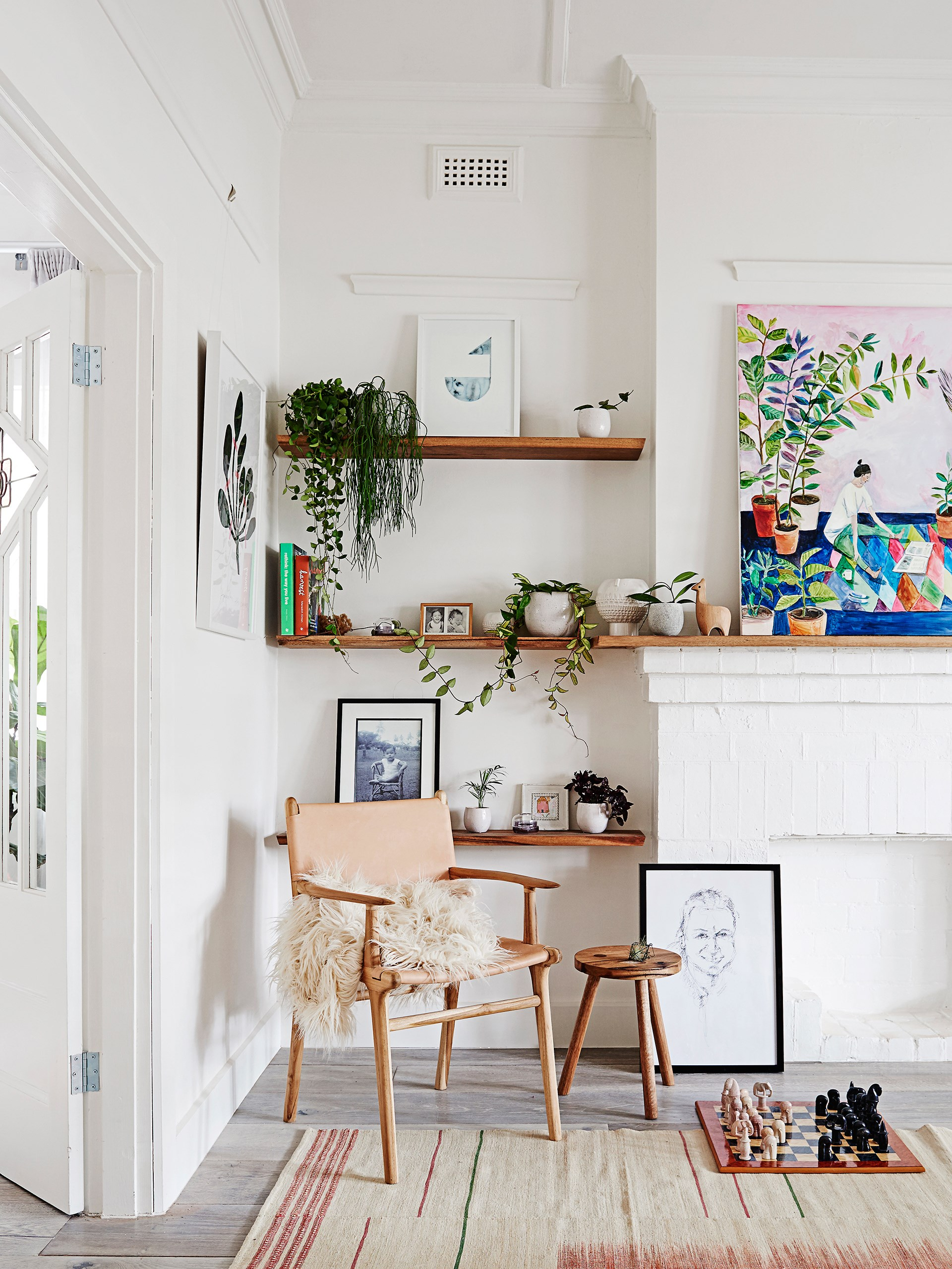 """The living room corner of [this California bungalow](http://www.homestolove.com.au/gallery-scandi-style-renovation-brings-bungalow-to-life-2053