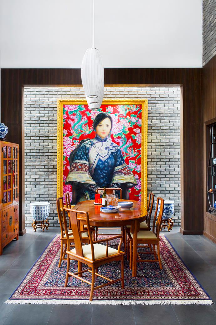 """The rear wall of the dining room was designed around an oversize artwork, *My Concubine* by Zhao Yingchao.   George Nelson Bubble **pendant lamps** from [Spence & Lyda](http://www.spenceandlyda.com.au/?utm_campaign=supplier/