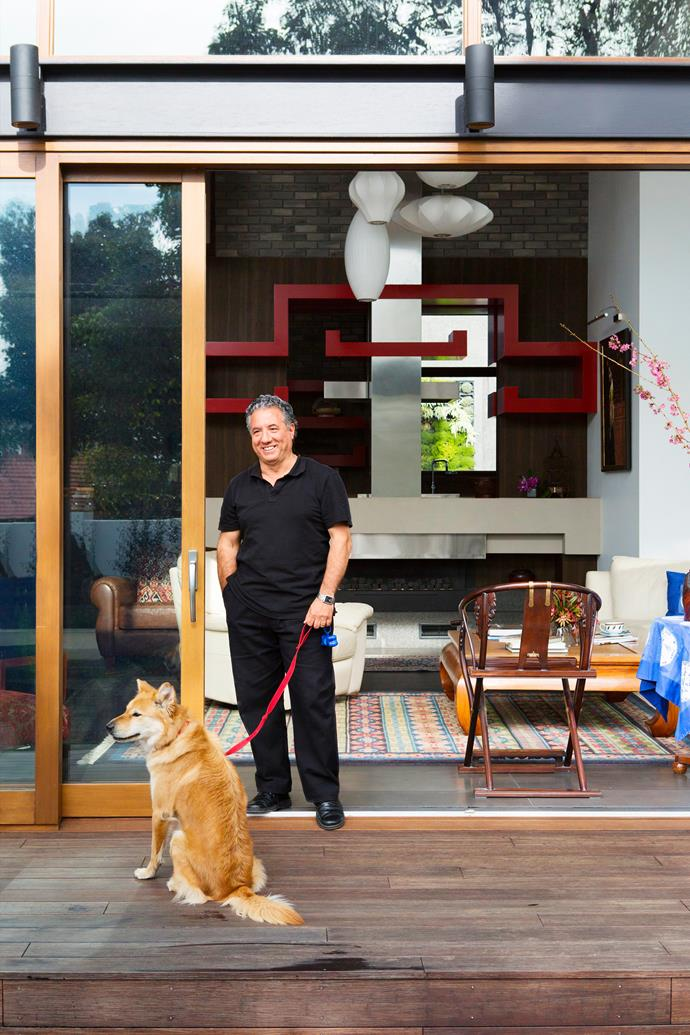 """""""This home balances the serenity of classic Chinese architecture with the easy indoor-outdoor flow of contemporary Australian design,"""" says architect Haluk Aysu, seen here with Karin and Wei's rescue dog, Xiao Mei."""
