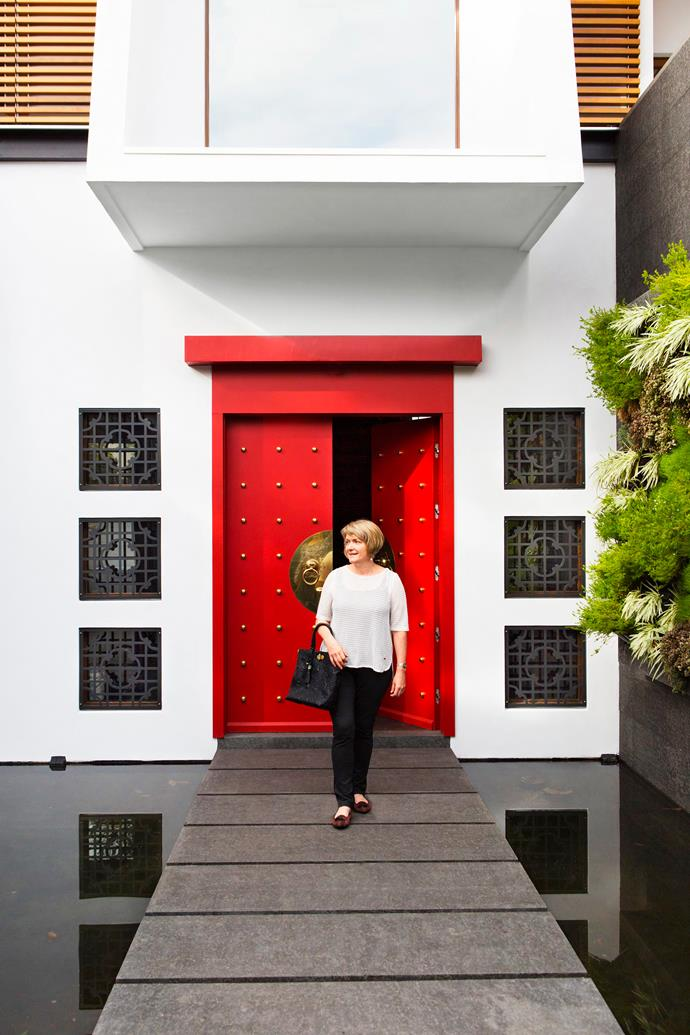 """Bluestone """"rafts"""" seem to float above a fishpond at the show-stopping front entrance of Karin Moorhouse's Melbourne home."""