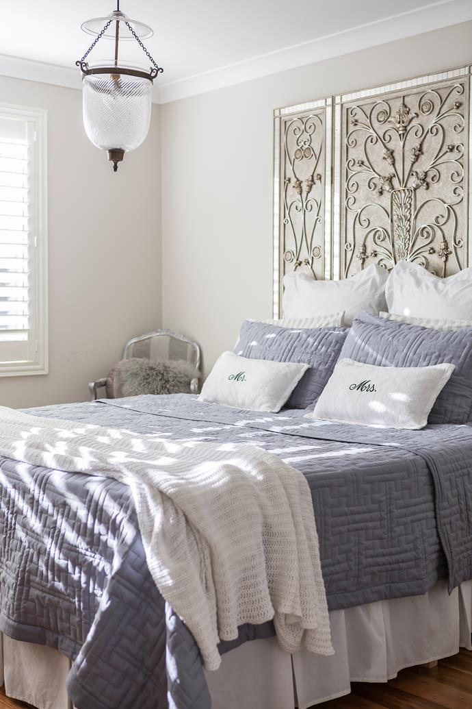 "A decorative bedhead bought overseas is a focal point in the master bedroom, along with the textured blue bedlinen from [Aldi](https://www.aldi.com.au/|target=""_blank"")."