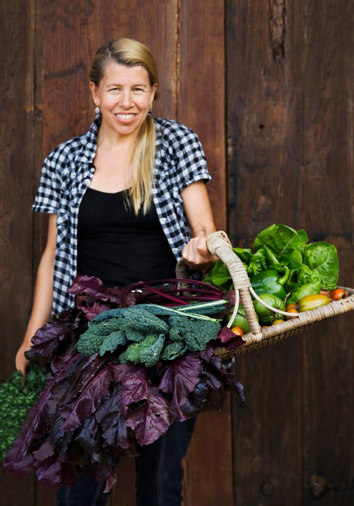 Brigid with her harvest of beetroot, lettuce and capsicum, among other goodies.