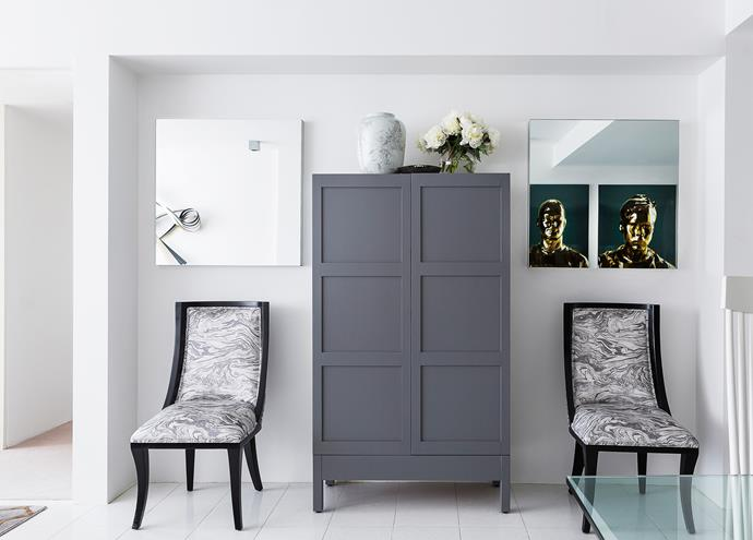 "Custom **bar cabinet** by [Brendan Wong Design](http://www.brendanwong.com//?utm_campaign=supplier/|target=""_blank"")."